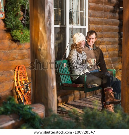 Happy Couple Relaxing on Swing - stock photo