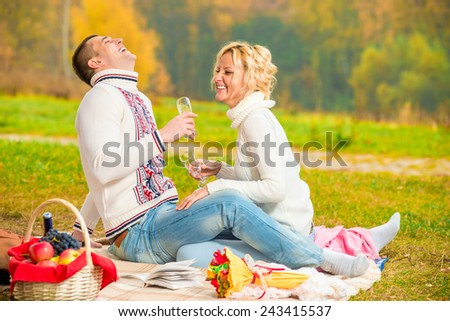 happy couple relaxing weekend on a picnic - stock photo