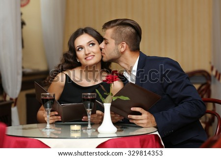 happy couple resting at the restaurant - stock photo
