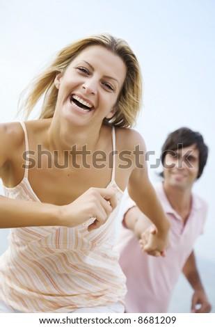 happy couple running - stock photo