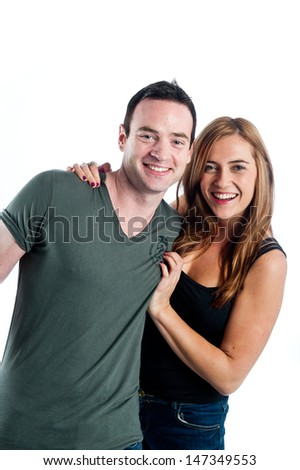 Happy couple smiling at the camera - stock photo