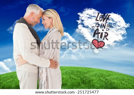 Happy couple standing and hugging against cloud heart - stock photo
