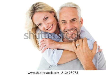 Happy couple standing and hugging on white background - stock photo