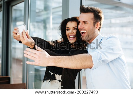 Happy couple taking a selfie with a smartphone - stock photo