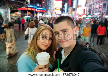 Happy couple traveling in New York city and drinking coffee - stock photo