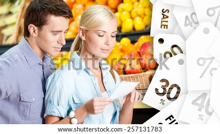 Happy couple watch store offer, sale labels background - stock photo
