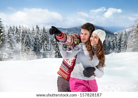 happy couple wearing warm clothes outside  - stock photo
