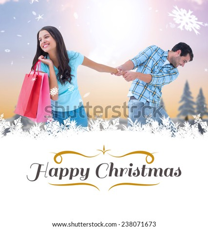 happy couple with shopping bag against border - stock photo