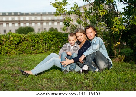 Happy couple with their son - stock photo