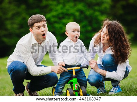 Happy couple with their son on the bicycle - stock photo