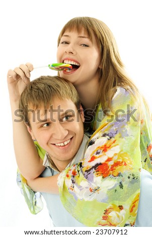 happy couple, young man giving his girlfriend piggyback ride - stock photo