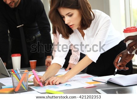 Happy creative business people in meeting in office - stock photo