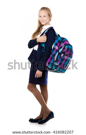 Happy cute beautiful blond schoolgirl wearing school uniform, holding checkered backpack with textbooks, posing, friendly smiling, isolated studio shot, white background, full length - stock photo