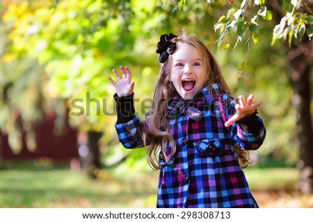 Happy cute girl in autumn fall outdoor - stock photo