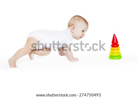 Happy cute laughing baby crawling to pyramid. Positive smiling  child. Smiling kid. Beautiful smiling cute funny baby. C�¡oncept of childhood, learning new - stock photo