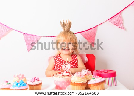 happy cute little girl with sweets at birthday - stock photo