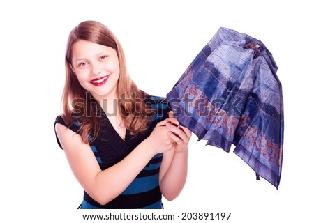 Happy cute teen girl opening umbrella and smiling - stock photo