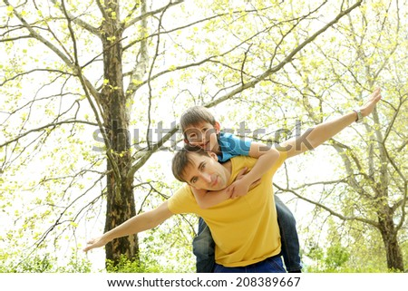 Happy dad and son in the park - stock photo
