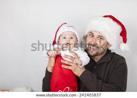 Happy dad with baby in festive clothes and Christmas interior,. Christmas, Holidays, New Year  - stock photo