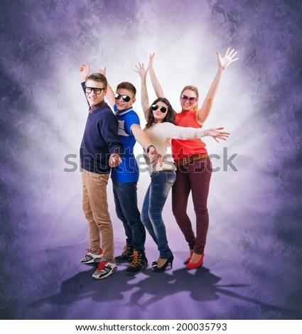 Happy Dancing teenage friends  - stock photo