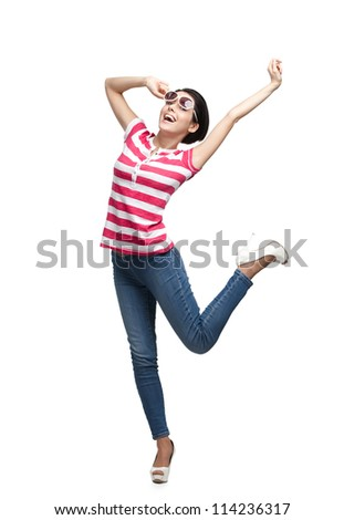 Happy dancing teenager with arms up, isolated on white background. Fashion model - stock photo
