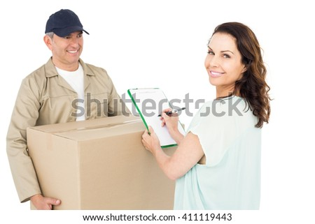 Happy delivery man giving package to customer on white background - stock photo