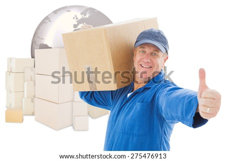 Happy delivery man holding cardboard box against logistics concept - stock photo