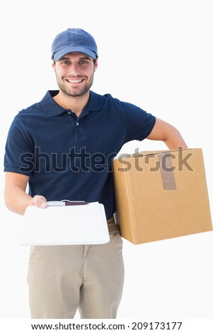 Happy delivery man with cardboard box and clipboard on white background - stock photo
