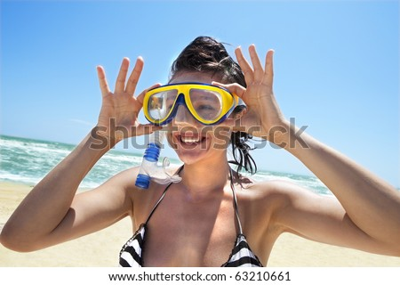 Happy diving girl in a swimming mask and snorkel - stock photo