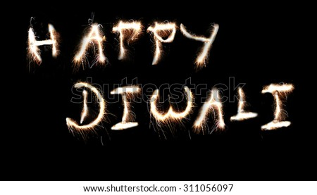 Happy Diwali message created using sparklers fireworks. - stock photo