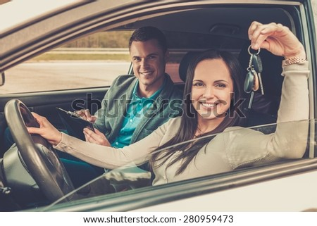 Happy driving student with a car keys - stock photo