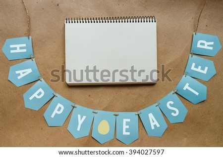 Happy Easter banner lettering on craft paper background. Space for text, copy. Greeting postcard template. - stock photo