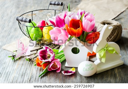 Happy Easter bunny and eggs vintage composition with flowers - stock photo