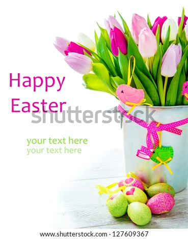 Happy Easter - flowers and colourful eggs - stock photo