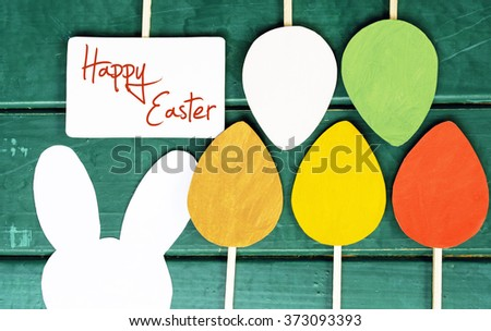 Happy Easter paper Rabbit Bunny Easter egg and poster on wooden Background - stock photo