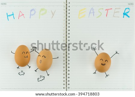 Happy eggs celebrates Easter, with children's drawing and copy space on blank notebook paper - stock photo