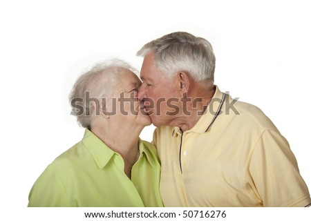 Happy elderly Caucasian couple posing on white background. - stock photo