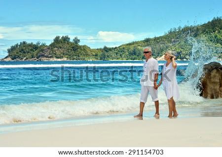 Happy elderly couple rest at tropical resort - stock photo