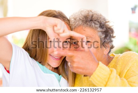 Happy elderly woman enjoy the time with her daughter - stock photo