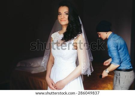happy elegant stylish luxury beautiful brunette bride with amazing curly hair - stock photo