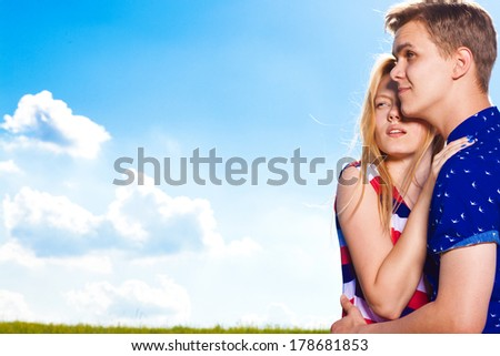 happy embracing couple  on the field - stock photo