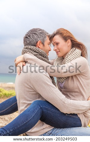 happy embracing lover couple on the beach - stock photo