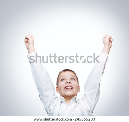 Happy emotional boy, hands up. - stock photo
