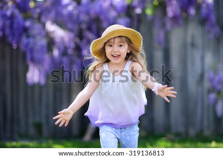 Happy emotional child girl om summer day outdoor - stock photo