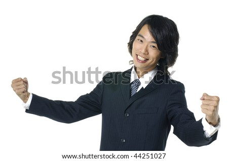 happy energetic businessman with his arms raised. - stock photo