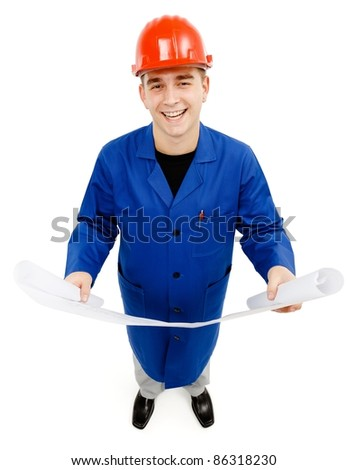Happy engineer looking up while holding project plans in both hands - stock photo