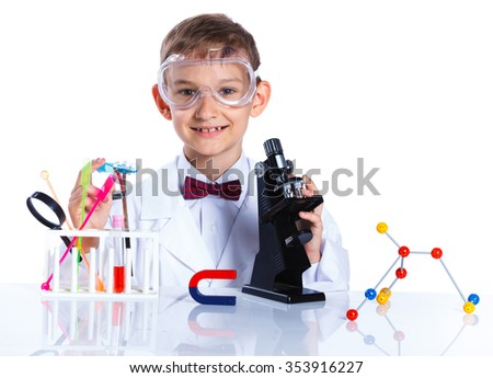Happy enthusiastic Chemist little boy with flasks for chemistry and microscope. Isolated on a white background - stock photo