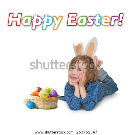 Happy ester greetings. Cute little boy lying on the floor beside a basket with Easter eggs, Happy Easter banner isolated on white background. - stock photo