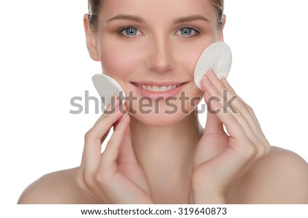 happy European woman with cotton pad, isolated on white - stock photo