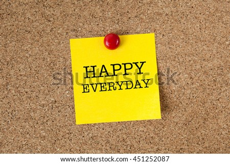 Happy everyday word with yellow reminder sticky note on cork board - stock photo